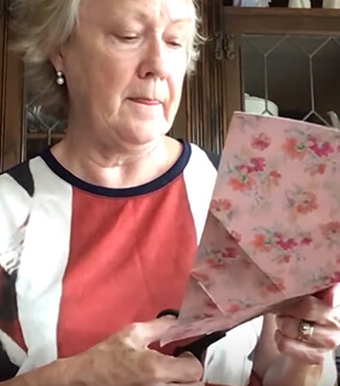 Woman cutting gift wrapping